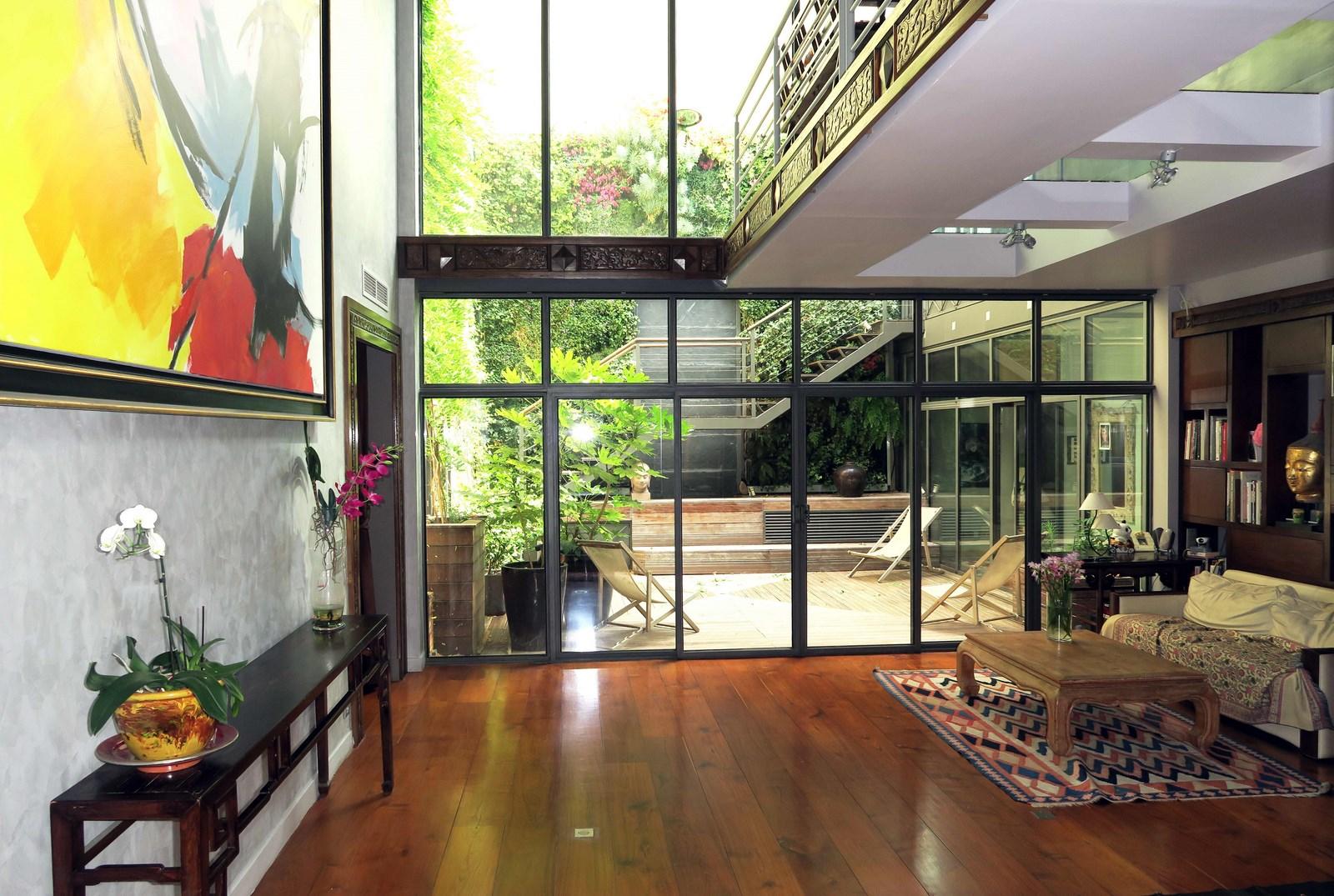 Paris 17e, Loft, comme une maison de 330 m² avec son patio intérieur, 4 chambres….